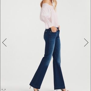 Flared mid-rise seven jeans